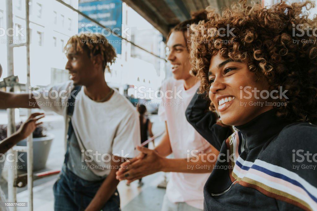 Friends hanging out in the city stock photo