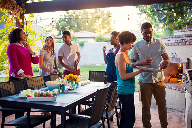 Friends hanging out together at a barbecue stock photo