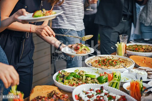 546450250istockphoto Friends Happiness Enjoying Dinning Eating Concept. Food Buffet. Catering Dining. Eating Party. Sharing Concept 815330216