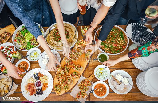 546450250istockphoto Friends Happiness Enjoying Dinning Eating Concept. Food Buffet. Catering Dining. Eating Party. Sharing Concept 815330240