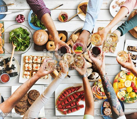 546450250istockphoto Friends Happiness Enjoying Dinning Eating Concept 523697434