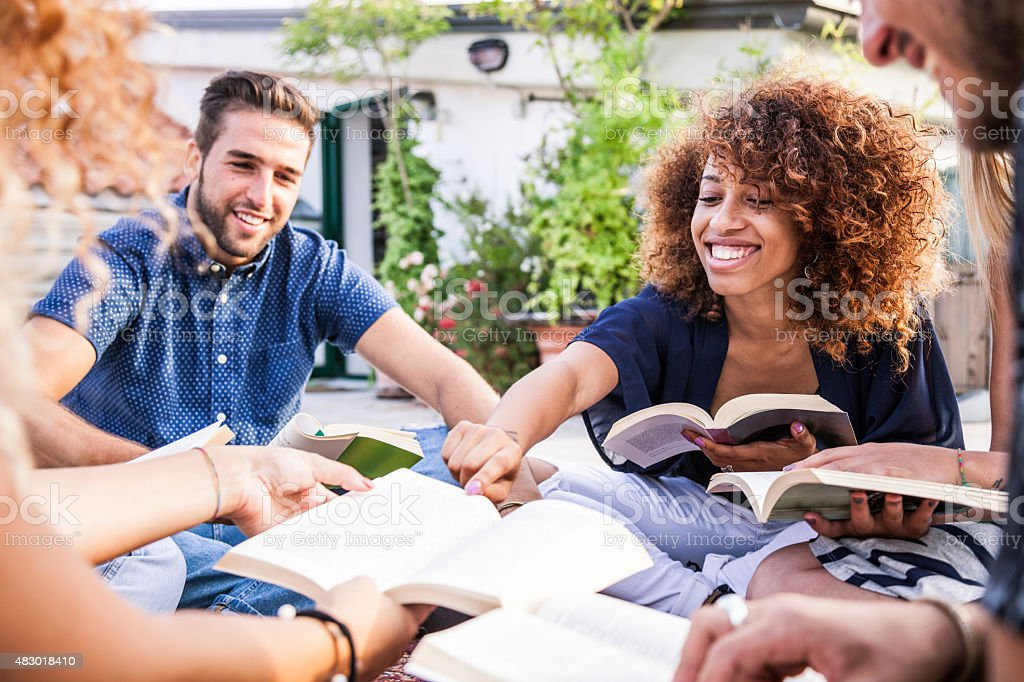 Friends have a public reading together stock photo