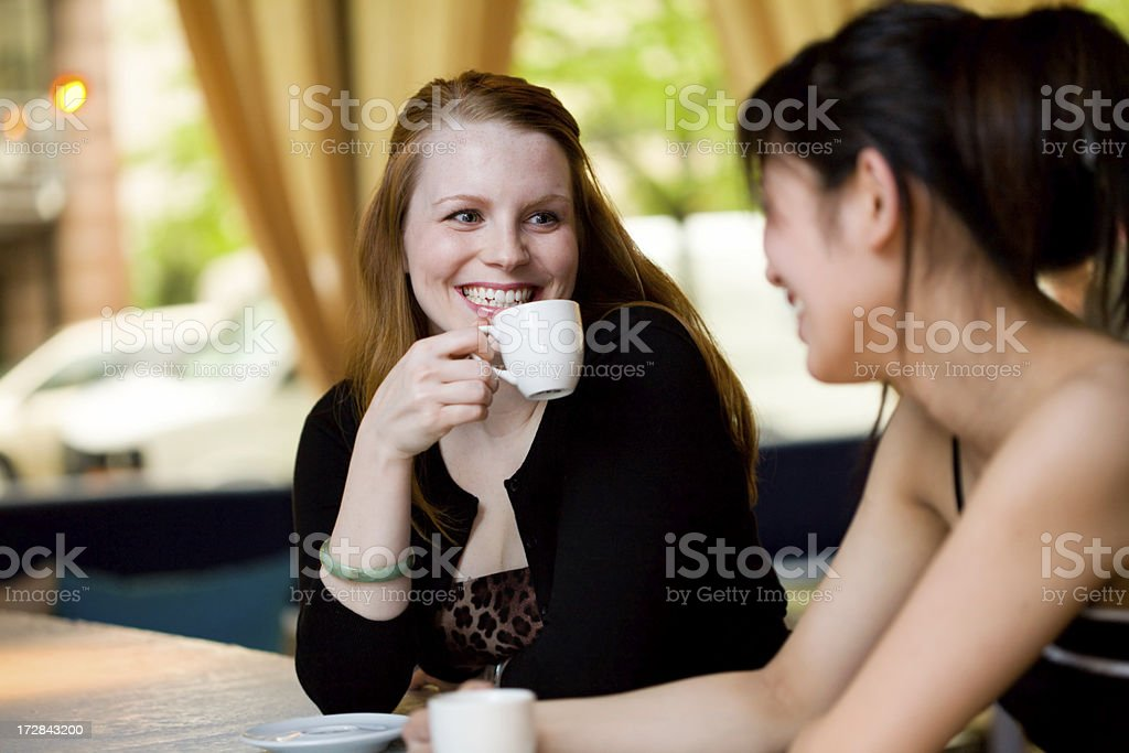 Friends have coffee and laugh royalty-free stock photo