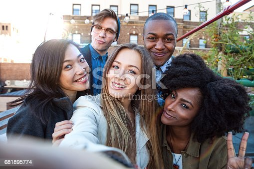 istock Friends have fun in a New York rooftop party 681895774