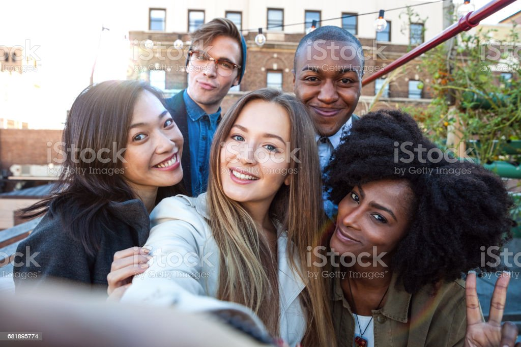 Friends have fun in a New York rooftop party stock photo