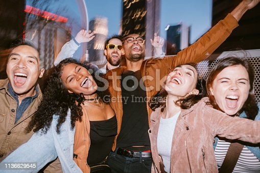 istock Friends Have Fun On Downtown Los Angeles Rooftop 1136629545