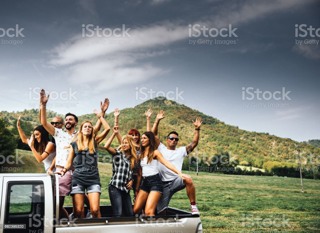 friends have fun on the van royalty-free stock photo