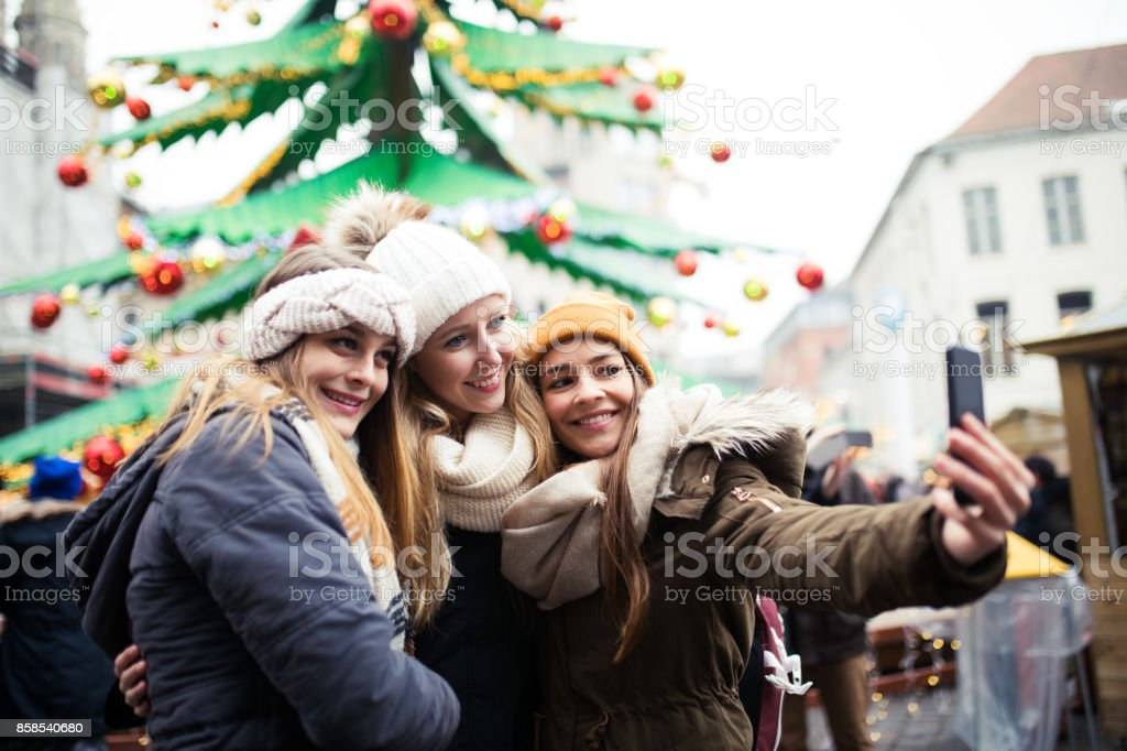 Friends have fun outdoor on Christmas