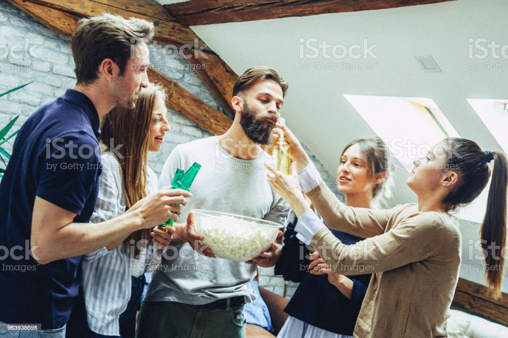 Friends have party time at the apartment - Royalty-free Adult Stock Photo