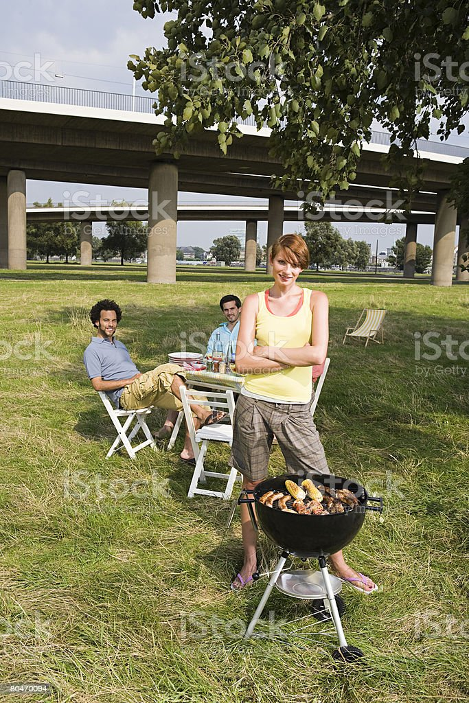 Friends having a barbecue near a flyover royalty-free stock photo