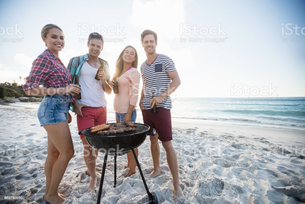 Friends having a barbecue stock photo