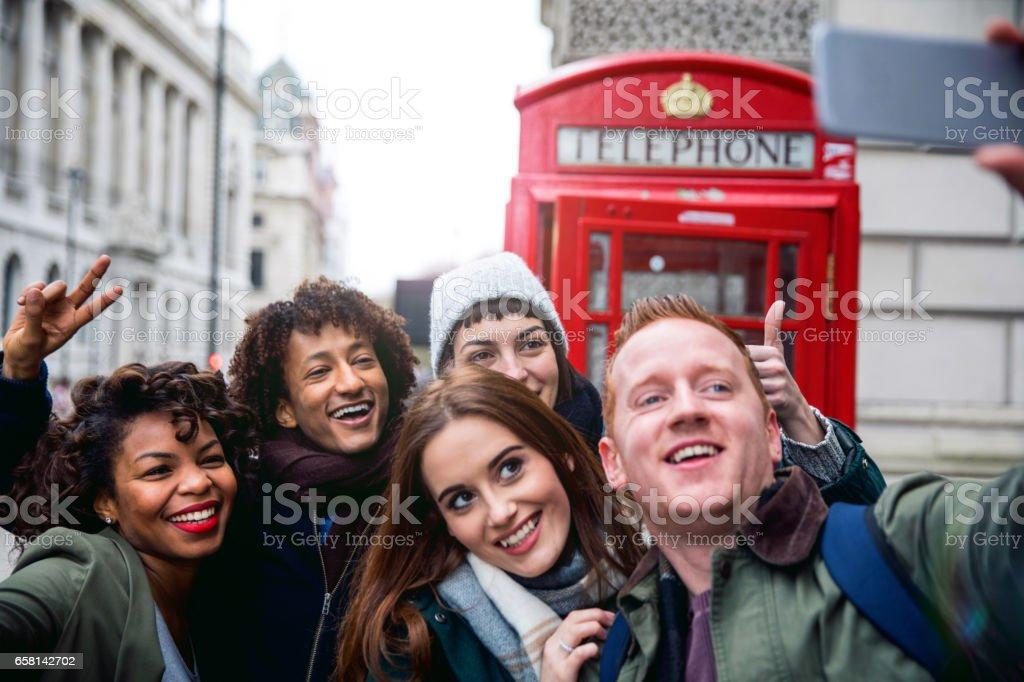 Friends having a blast in London stock photo