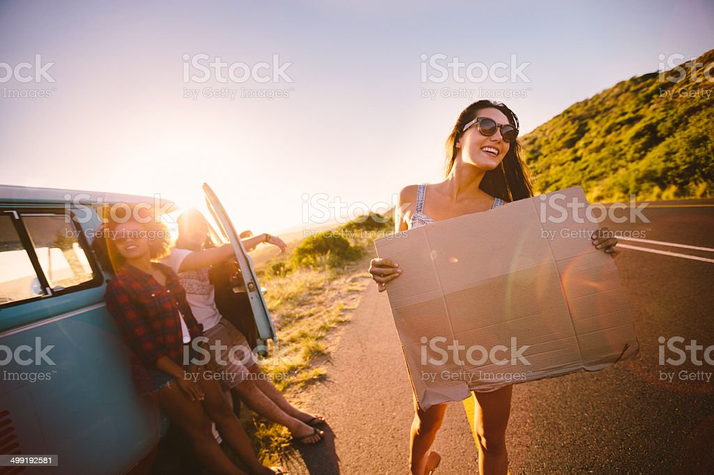 Friends having a car breakdown stock photo