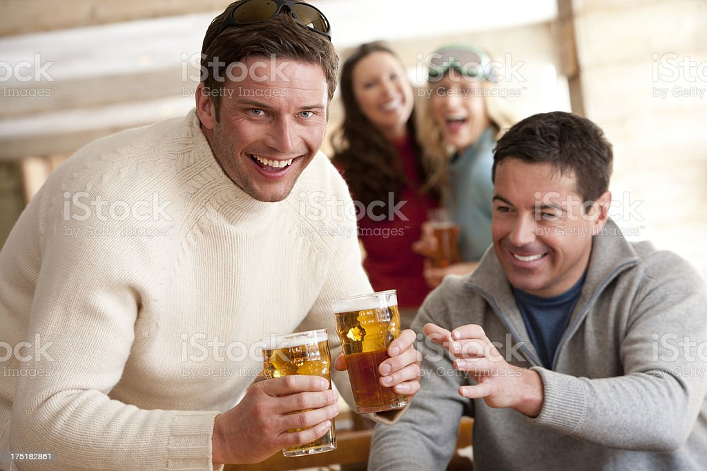 Friends having a drink royalty-free stock photo