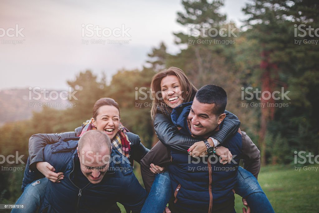 friends having a good time outside and laughing stock photo