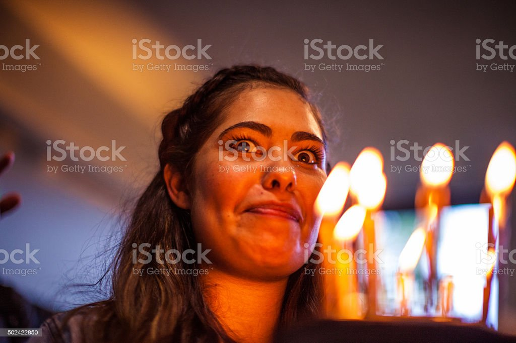 Friends having a lot of fun at birthday party stock photo