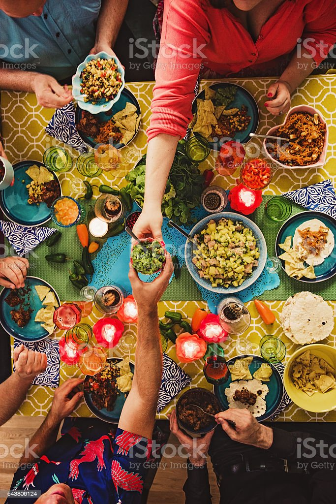 Friends having a Mexican tex mex dinner stock photo