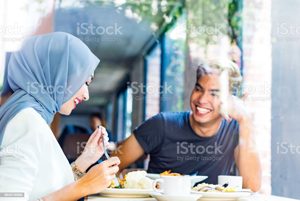 Friends having a weekend meal together at a restaurant stock photo
