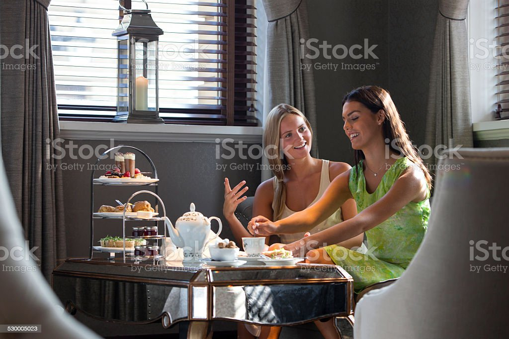 Friends Having Afternoon Tea stock photo