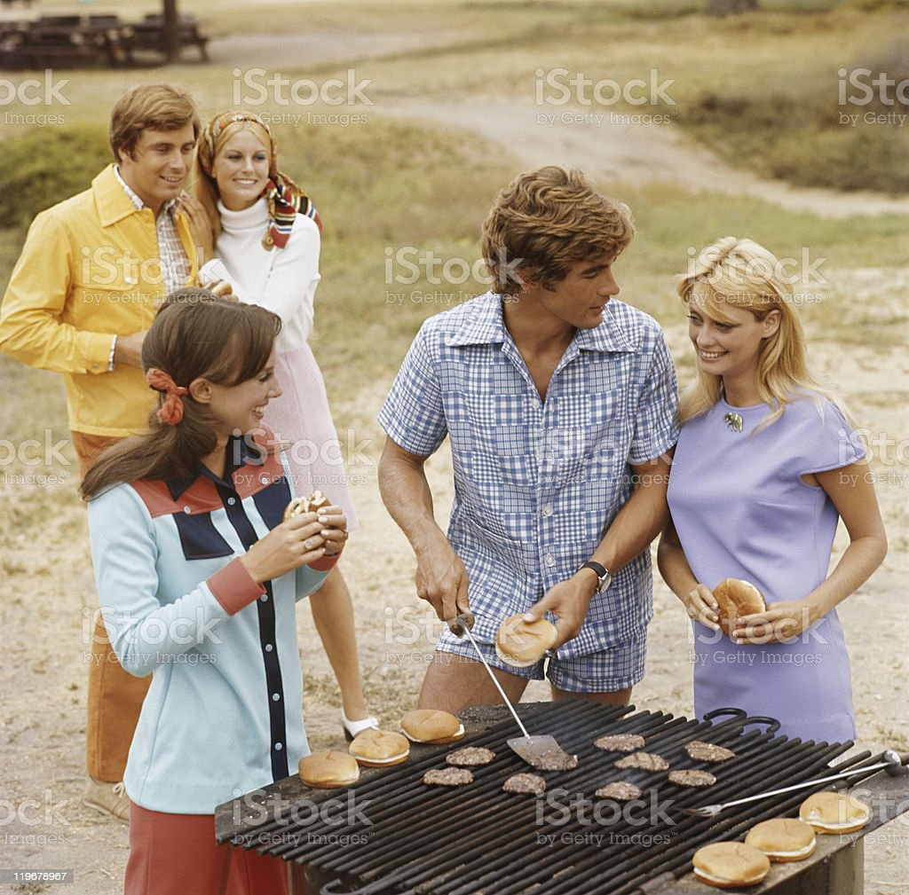 Friends having barbecue, smiling stock photo