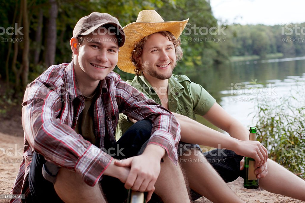 Friends having beer at the lake royalty-free stock photo