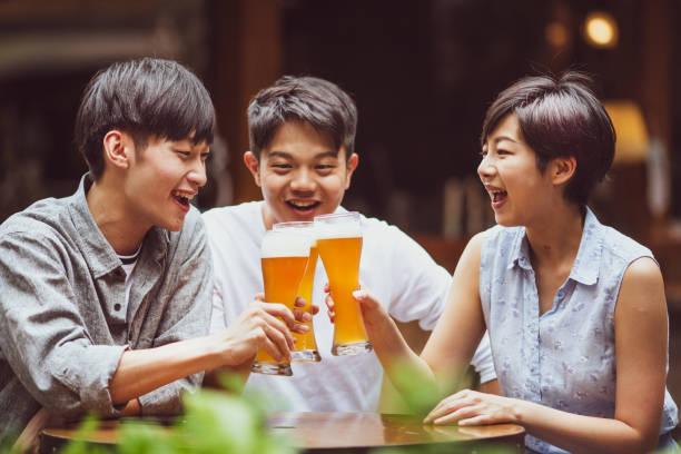Friends having beer stock photo