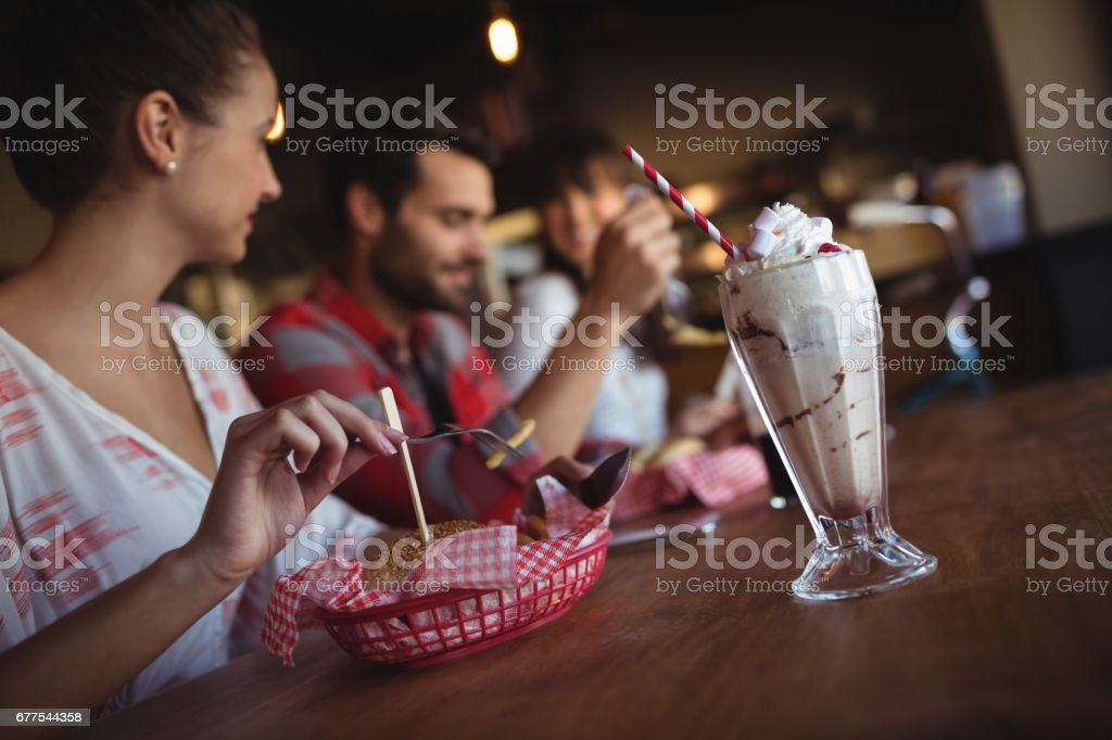 Friends having burger together royalty-free stock photo