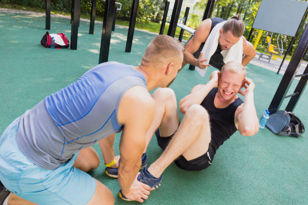 Friends having calisthenics workout stock photo