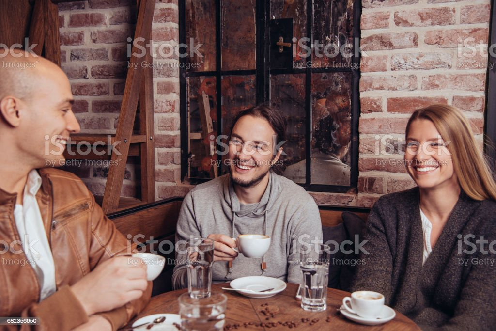 Friends having coffee in cafe foto stock royalty-free