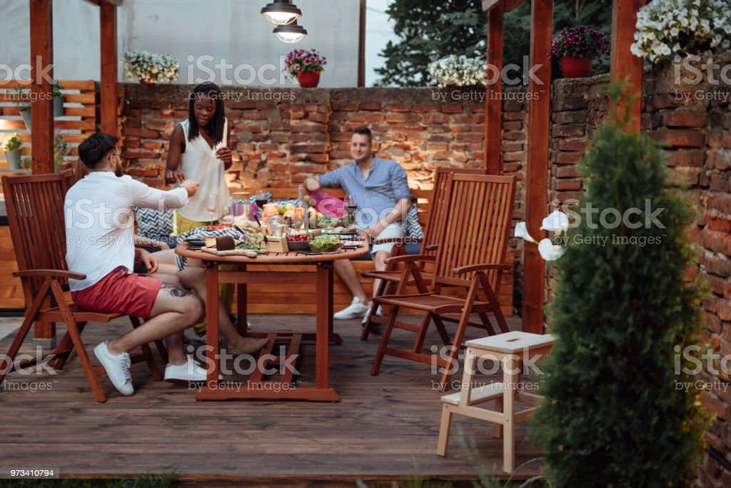 Friends having dinner in garden stock photo