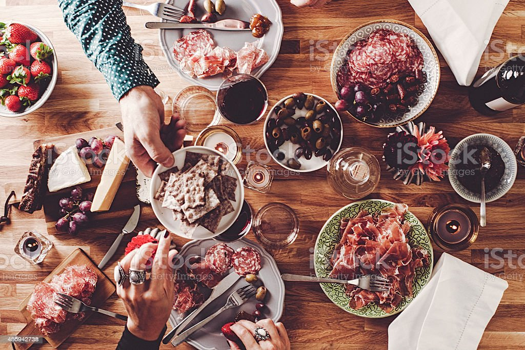 Friends Having Dinner Overhead Table Top View Stock Photo More