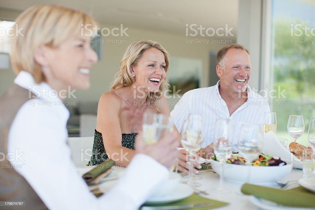 Friends having dinner together stock photo