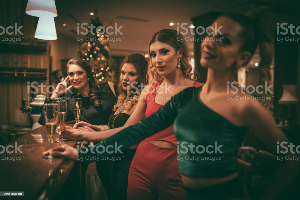 Friends having drink in bar stock photo