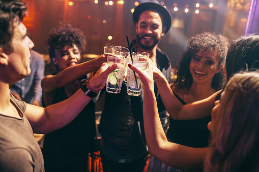 Friends Having Drinks At The Night Club Party Stock Photo - Download Image Now