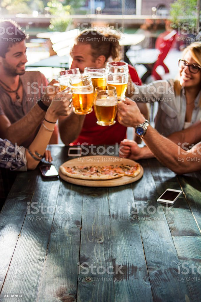 Friends having drinks in a bar stock photo