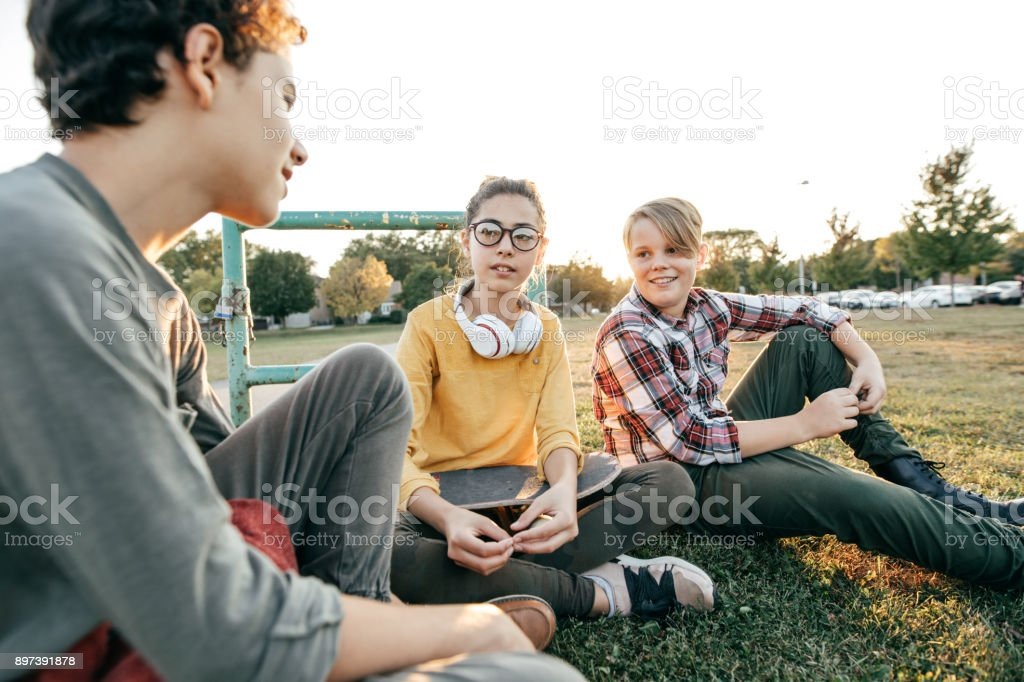 Friends having fun after school stock photo