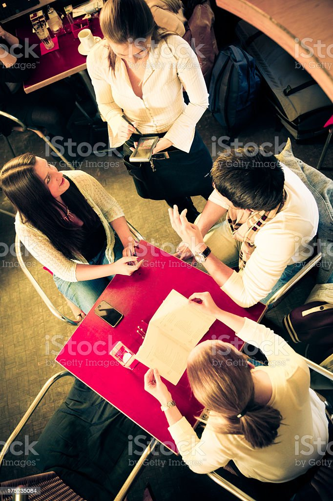friends having fun at a cafe royalty-free stock photo