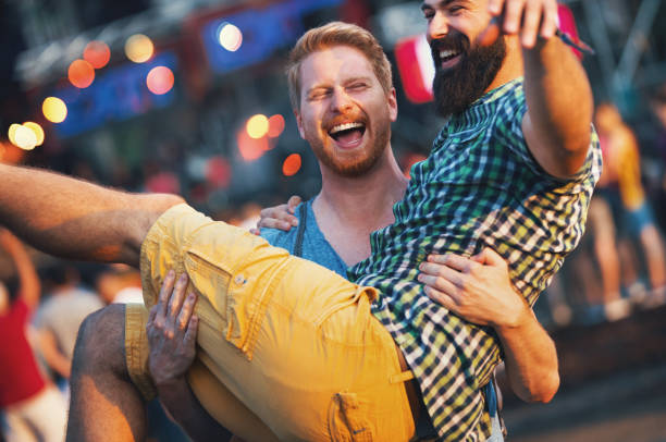 Friends having fun at a concert. stock photo