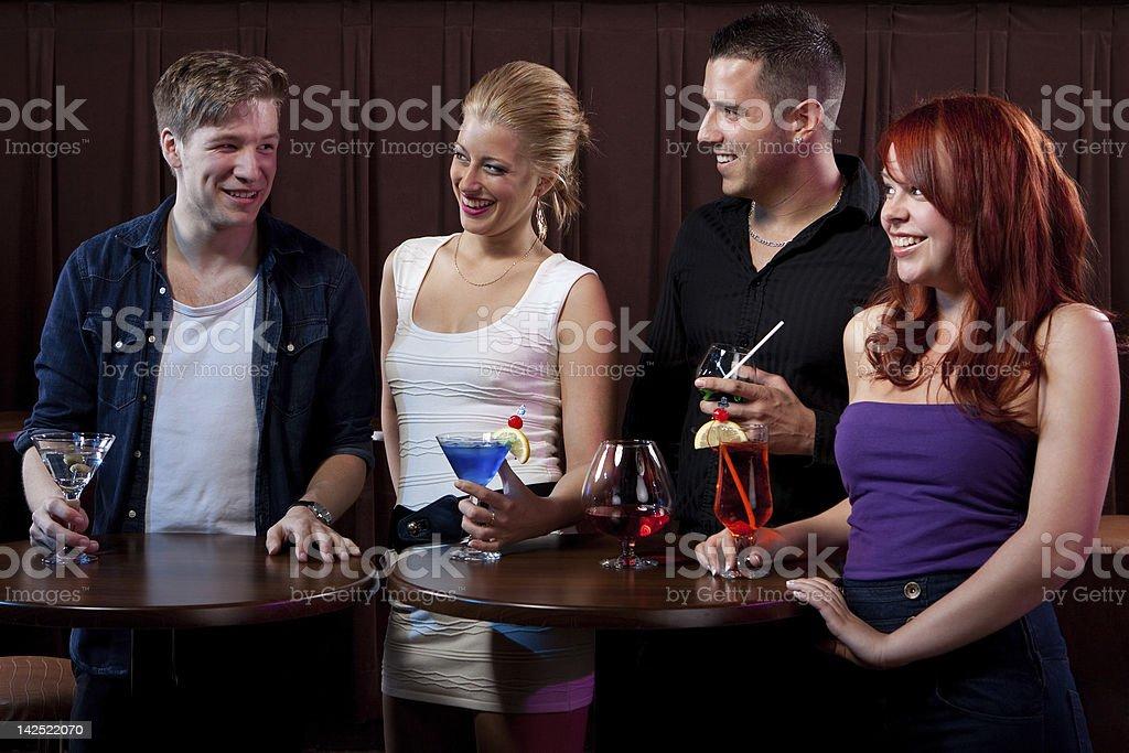 Friends having fun at a nightclub stock photo