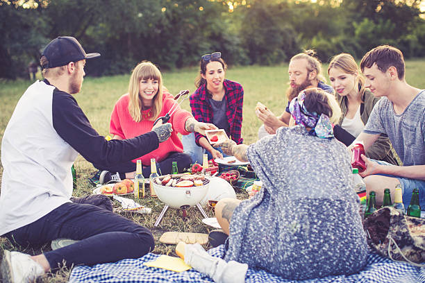 Friends having fun at barbecue party stock photo