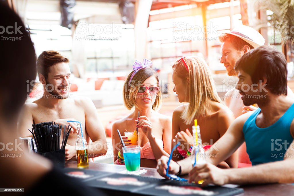 Friends having fun at beach bar stock photo