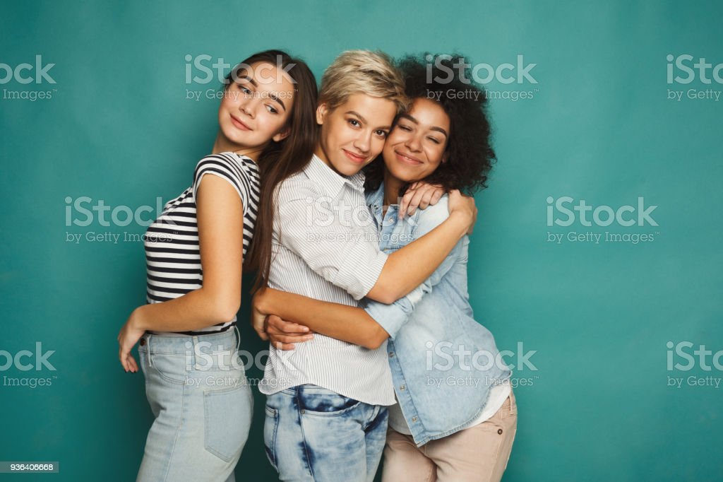 Friends having fun at blue background stock photo