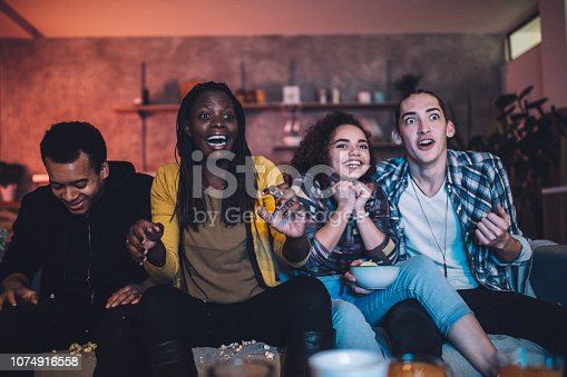 Group of multi ethnic people, friends sitting at home, having fun together.