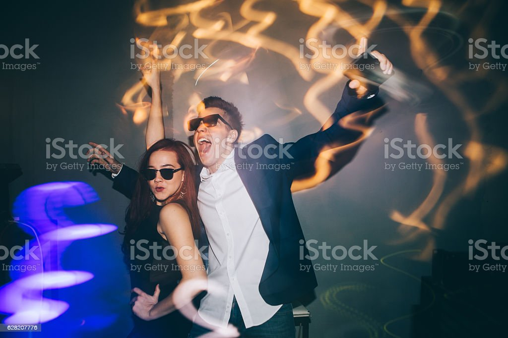 Friends having fun at New Year party stock photo