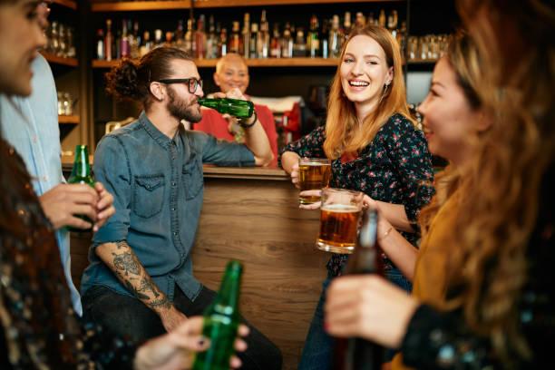 Friends having fun at pub. stock photo