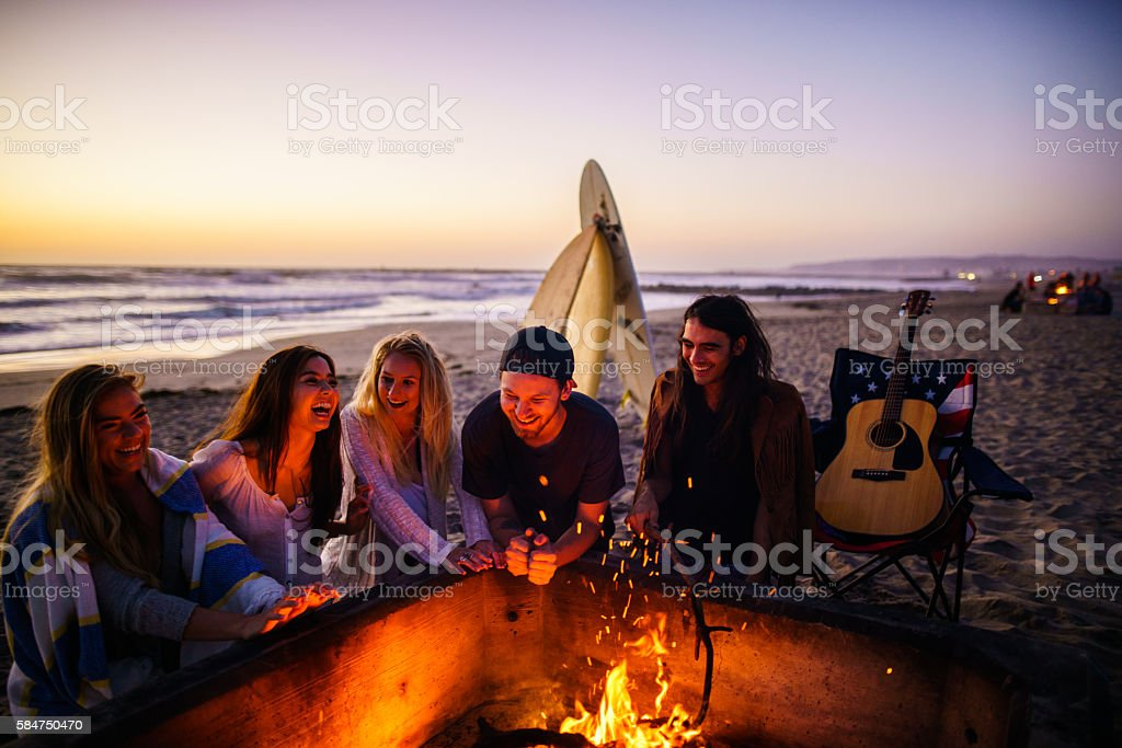 Friends having fun at San Diego beach stock photo