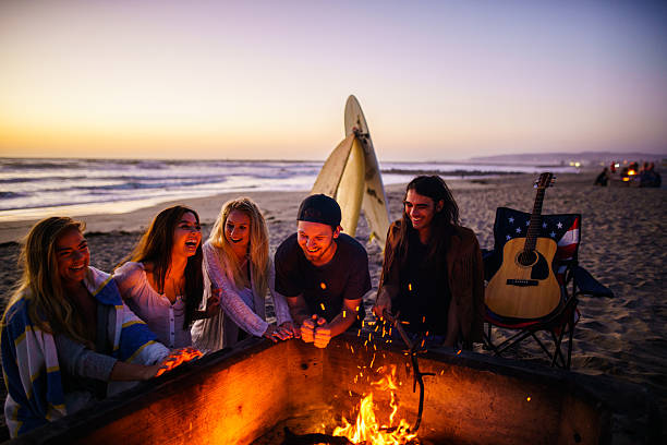 Friends having fun at San Diego beach Friends having fun at San Diego beach bonfire stock pictures, royalty-free photos & images