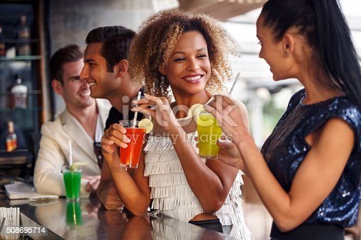 511875398 istock photo Friends having fun at the bar outdoor 508695714