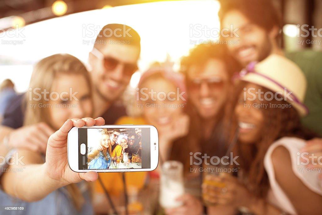 Friends having fun at the bar. stock photo