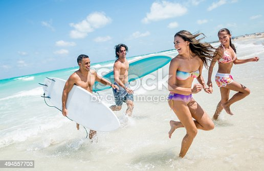 Friends having fun at the beach and enjoying the summer